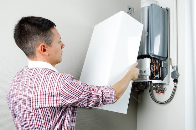 Plumber attaches trying to fix the problem with the residential heating equipment