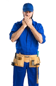 Plumber covering his mouth