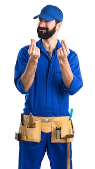 Plumber doing a money gesture