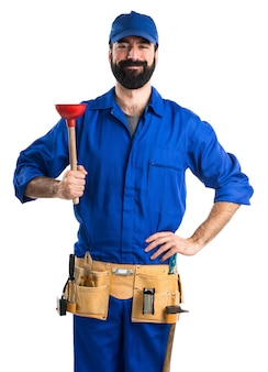 Plumber holding a plunger