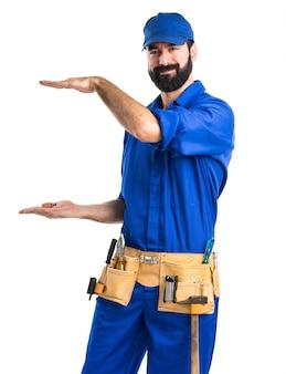Plumber holding something