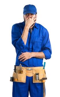 Plumber making smelling bad gesture