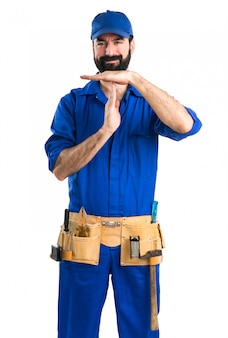 Plumber making time out gesture