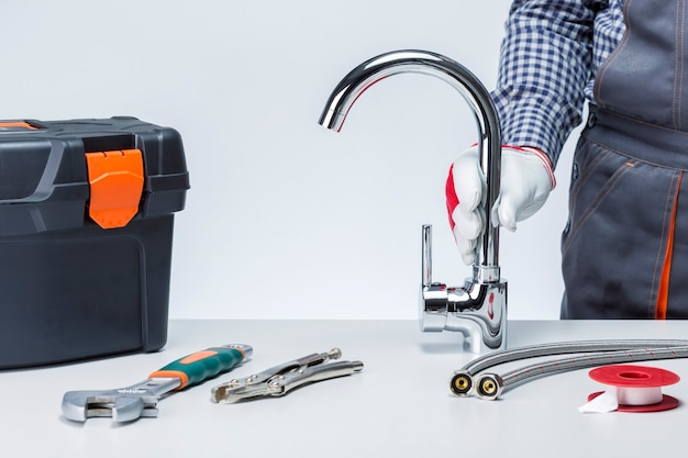Plumber with faucet and toolbox with tools