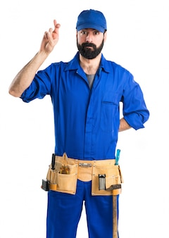 Plumber with his fingers crossing