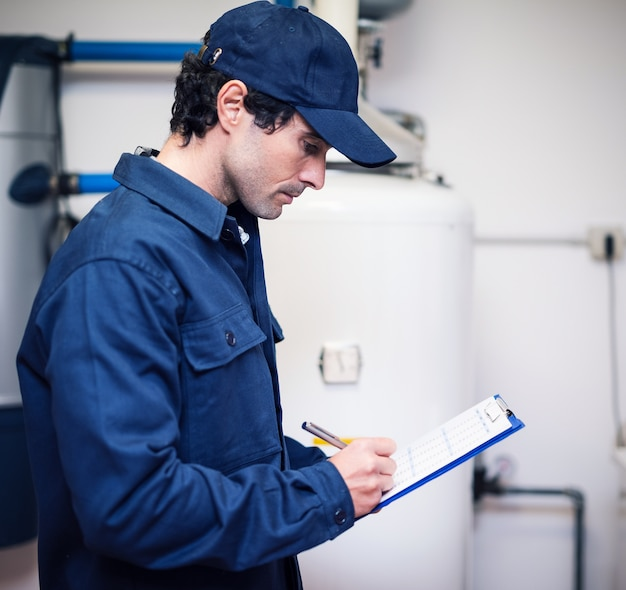 Plumber writing on a document