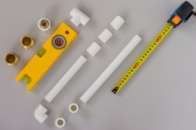 Plumbing fixtures and piping parts with measuring level and ruler. plumbing flat lay concept background with copy space.
