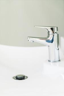 Plumbing tap bathroom equipment closeup