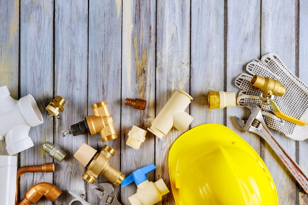 Plumbing tools repair bathroom fixtures fittings are of different construction wooden worktable.