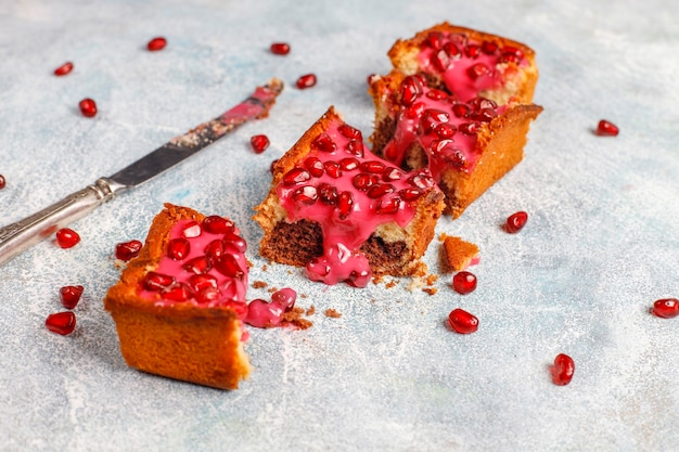 Plumcake with pomegranate topping and seeds.