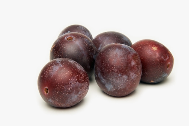 Plums fruit on white