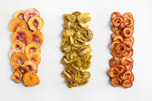 Plums kiwi peach chips as food background free sugar