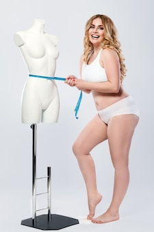 Plus size model and dummy female torso