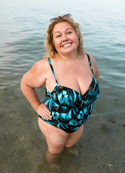 Plus size model standing in the water high view