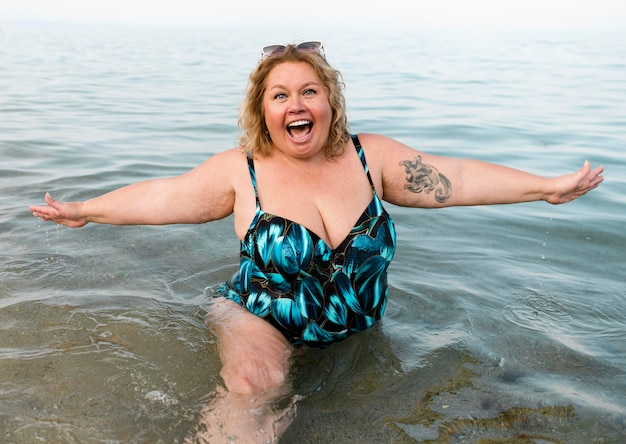 Plus size model standing in the water