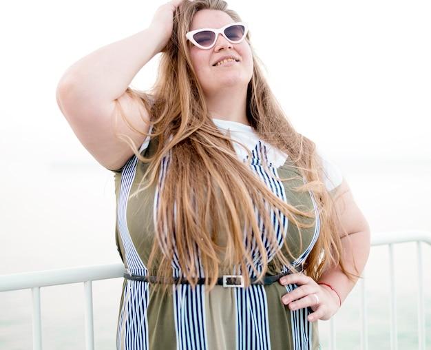Plus size model wearing sunglasses