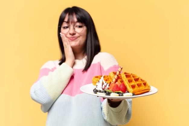 Plus size pretty woman eating waffles