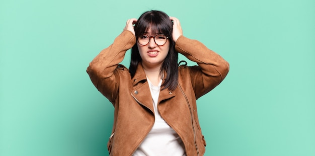 Plus size pretty woman feeling frustrated and annoyed, sick and tired of failure, fed-up with dull, boring tasks