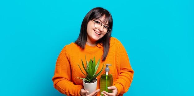 Plus size pretty woman holding cactus. aloe vera concept