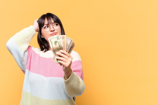 Plus size pretty woman with dollar banknotes