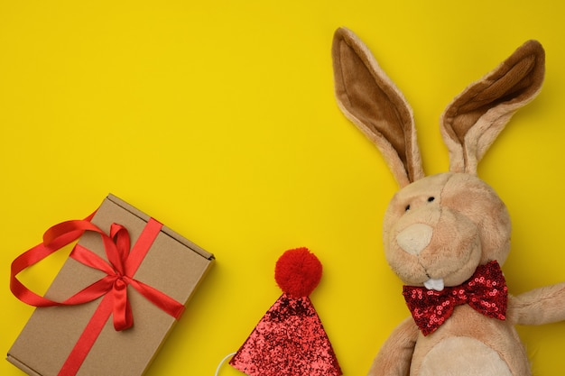 Plush brown rabbit, gift in a box, top view