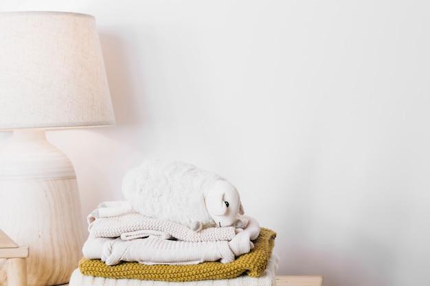 Plush sheep on blankets