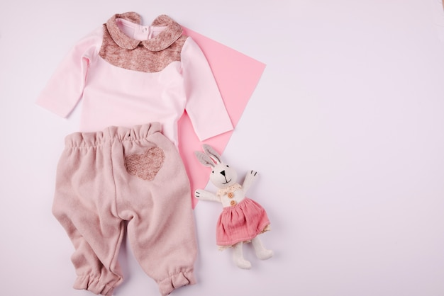 Plush toy and baby clothes top view