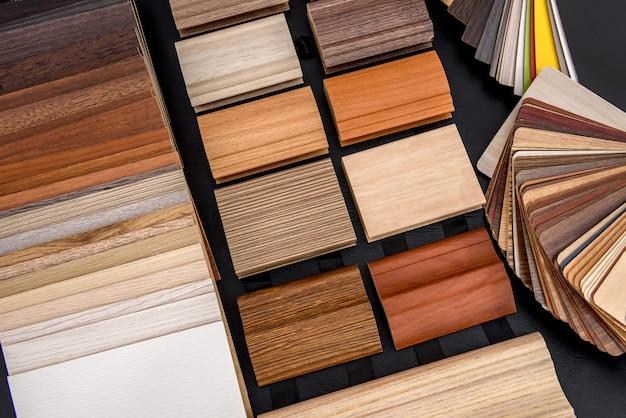 Plywood sampler in fan at wooden desk close up