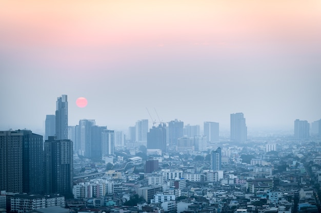 Pm 2.5 dust in bangkok,capital city are covered by heavy smog,sunset in downtown with bad air pollution, the place to risk of cancer, environmental problem