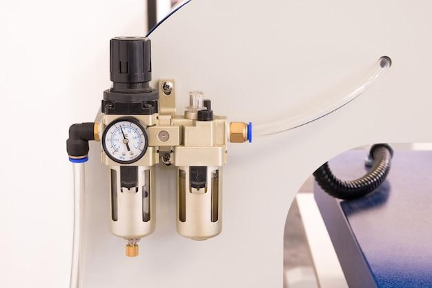 Pneumatic valve meter or pressure control machine.