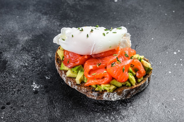 Poached egg on grilled toast with smoked salmon and avocado