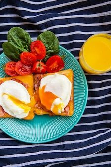 Poached egg on toasted english toast with spinach