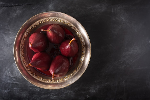 Poached pears in red wine with cinnamon and anise