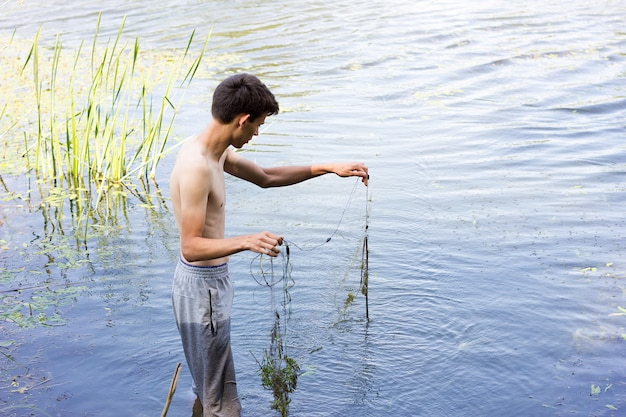 Poachers collects nets in the spring season. poaching on the water.
