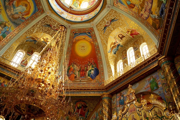 Pochaiv, ukraine -2021: lavra orthodox christian monastery complex transfiguration cathedral interior cupola ceiling fresco of god jesus christ