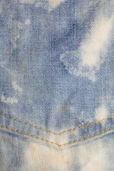 ポケットブルージーンズの織り目加工の背景。