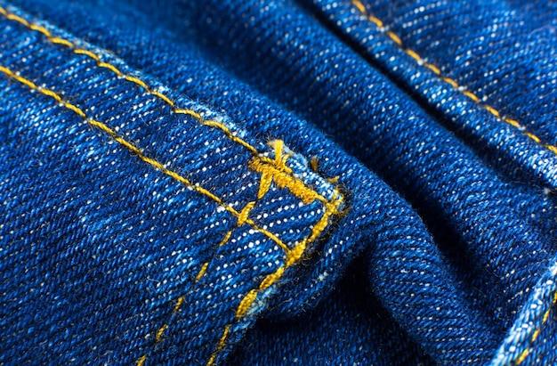 ブルーヒップスタージーンズ素材のポケット。デニムクロスのテクスチャ背景。