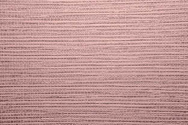 ポックマークのビニール壁紙の背景テクスチャ。デザインの要素。ローズクォーツのファッションとホームカラー。 2016年のカラー