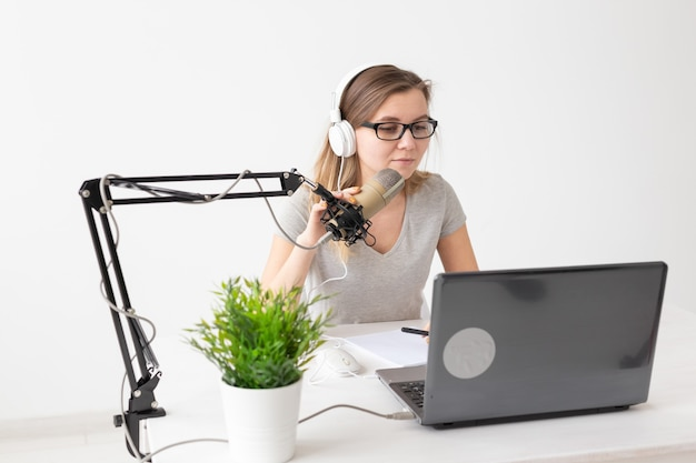 Podcasting, music and radio concept - woman speaking on the radio, working as a presenter