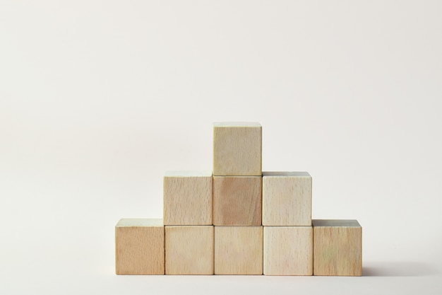 Podium for product presentation. minimalistic staircase made of wooden cubes.