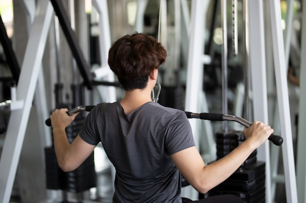 Poeple exercise in fitness gym