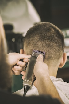 Point of view. closeup shot of a barber using trimmer