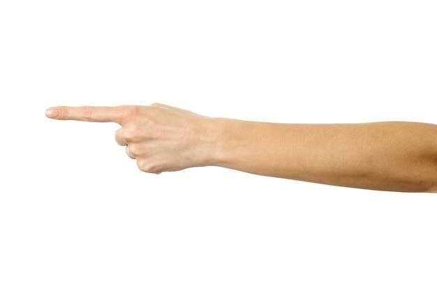 왼쪽을 가리키고 있습니다. 프랑스 매니큐어 몸짓 흰색 벽에 고립 된 여자 손. 시리즈의 일부