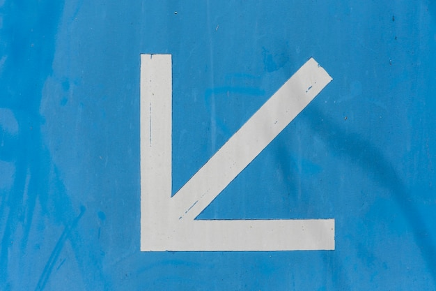 Pointy white arrow on blue background