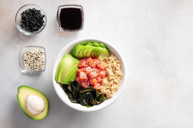 Poke bowl with salmon, quinoa, wakame seaweed