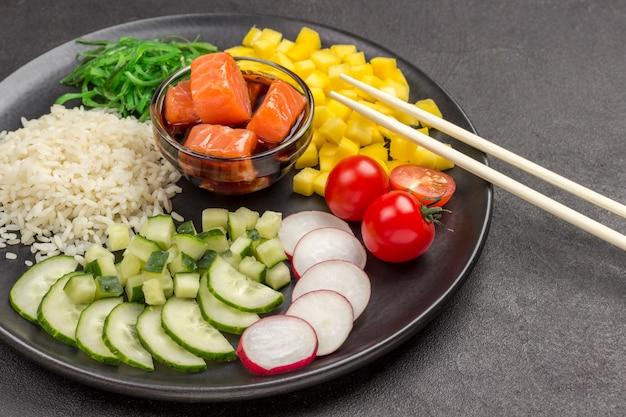 Poke traditional hawaiian raw red fish salad, with bamboo chopsticks. organic healthy nutrition
