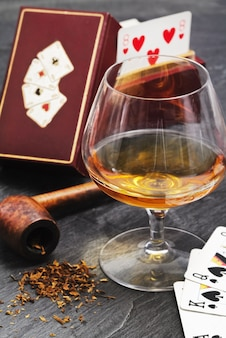 Poker, brandy and smoke pipe