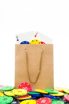 Poker cards and poker chips in bag isolated on white background