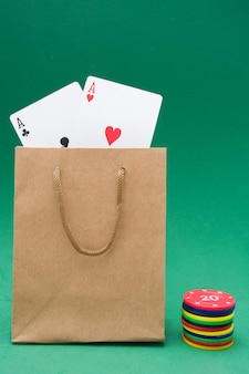 Poker cards and poker chips on green background