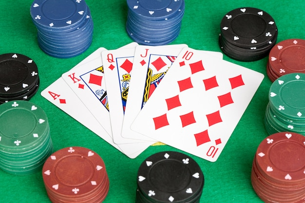 Poker cards with straight flush and many chips